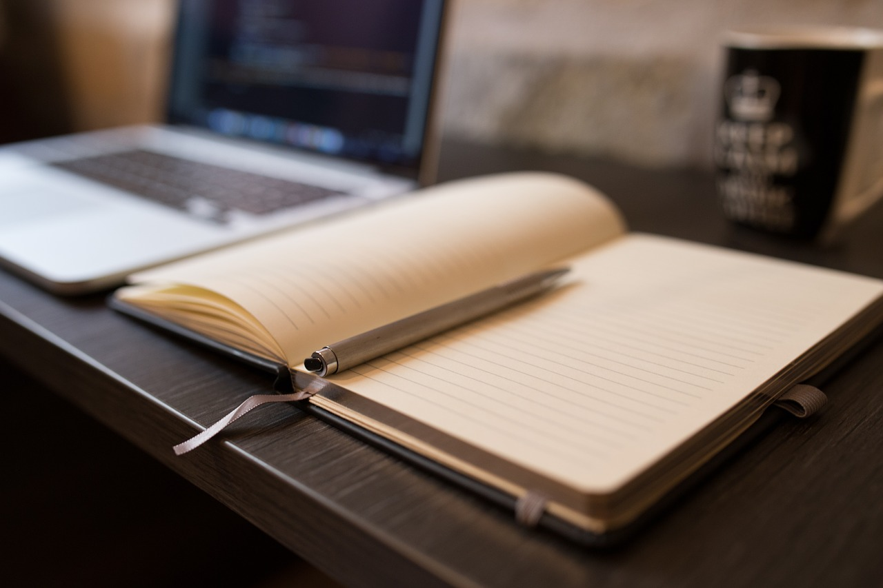 Open Book with Pen On Desk